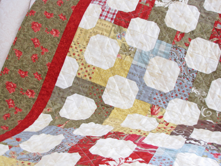 All in the Family Roman Holiday Moda Quilt Closeup