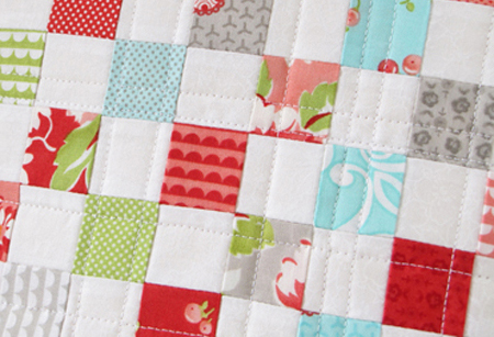 Bonnie and Camille Fabric Ruby Dream On Pillow Close Up Stitching
